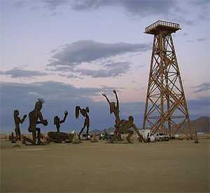 oil derrick and the statues kneeling before it